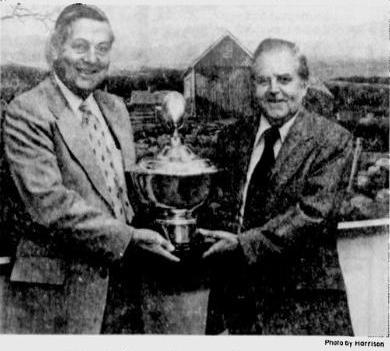 Shaw and Coffey holding the Stoddard Silver Bowl